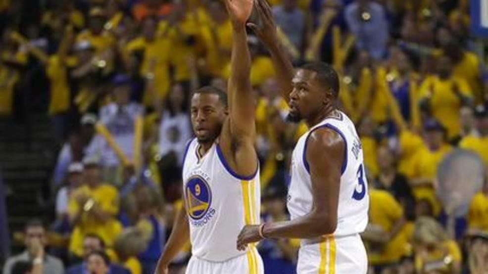 a29bd47da Golden State Warriors forward Andre Iguodala (9) and forward Kevin Durant  (35) react after scoring against the Cleveland Cavaliers during the first  half of ...
